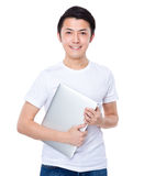 Asian man with laptop Royalty Free Stock Image
