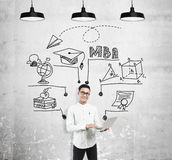 Asian man with laptop and MBA sketch Stock Image