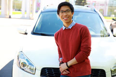 Asian man leaning on the car Royalty Free Stock Images