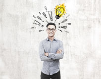 Asian man, light bulb and exclamations, concrete Stock Photos