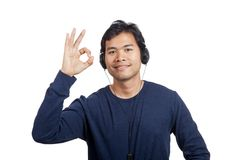 Asian man listen to music show OK sign. Isolated on white background Stock Photography