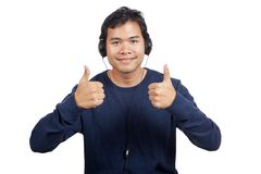 Asian man listen to music show thumbs up with both hands. Isolated on white background Royalty Free Stock Images