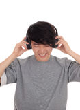 Asian man listen to music. A young handsome Korean teenager listen to music with his headset, in a gray t-shirt, isolated for white background Royalty Free Stock Photos