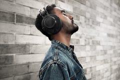 Asian man listening music on outdoor stock image