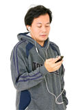 Asian Man Listening Music From Smartphone. Royalty Free Stock Photo
