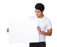 Asian man look down the white cardboard Royalty Free Stock Image