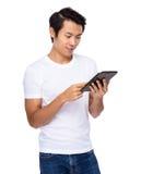 Asian man look at tablet Stock Photos