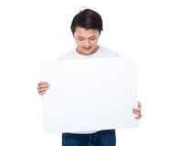 Asian man look at white board Stock Photo