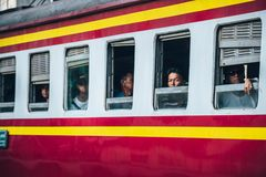 Asian man looked out from train windows royalty free stock photography