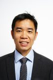 Asian man looking professional and smiling to the camera Royalty Free Stock Photography