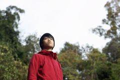 Asian man looking up outdoors Stock Image