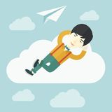 Asian man lying on a cloud with paper plane Stock Photography