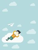 Asian man lying on a cloud with paper plane Royalty Free Stock Photo