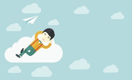 Asian man lying on a cloud with paper plane Royalty Free Stock Images