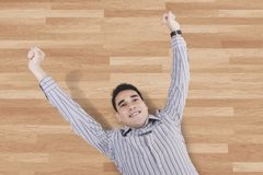 Asian man lying on the wooden floor Royalty Free Stock Image