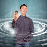 Asian Man Making An Avatar. On cell phone in social network royalty free stock photos
