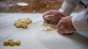 Asian man making fresh dumplings in a kitchen restaurant of Taiwan royalty free stock photo