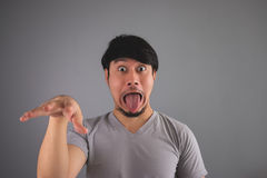 Asian man is making funny face. royalty free stock photos