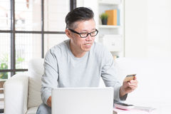 Asian man making online payment Stock Photos