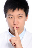 Asian man making a shushing gesture Stock Images