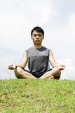 Asian Man meditating Royalty Free Stock Photography