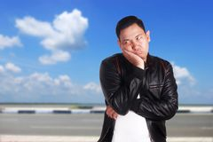 Asian Man in Moody Depressed Expression Stock Image
