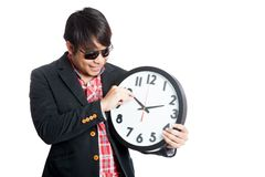 Asian man move minute hand clock and smile. Isolated on white background Stock Images