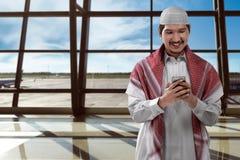 Asian man muslim on airport Stock Image