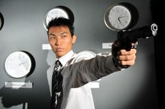Asian Man in office with a Gun Stock Photos