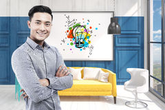 Asian man in office and light bulb Royalty Free Stock Photos
