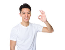 Asian man with ok sign gesture Royalty Free Stock Photo