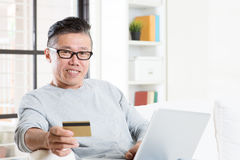 Asian man online shopping Stock Images