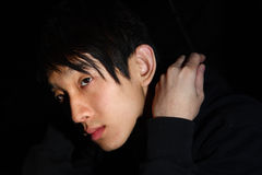Asian man over dark background Stock Image