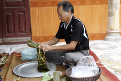 Asian man packing rice cake Royalty Free Stock Photo