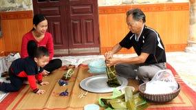Asian man packing rice cake Royalty Free Stock Image