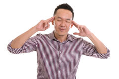 Asian man with pensive expression Stock Photo