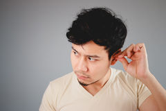 Asian man picking ear. Stock Images