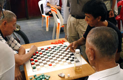 Asian man playing Go Stock Images