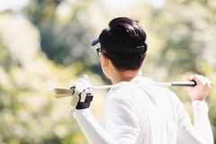 Men playing golf stock photos