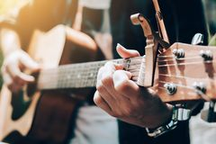 Asian man playing guitar and catch chord. Asian man playing guitar and catch chord Stock Photo
