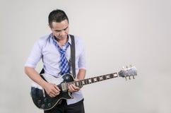Asian man playing guitar. Asian man playing electric guitar stock images