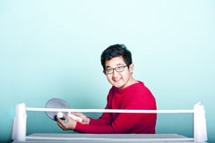 Asian man playing table tennis  Royalty Free Stock Photos
