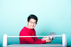 Asian man playing table tennis Stock Photo