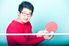 Asian man playing table tennis Stock Photos