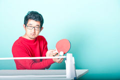 Asian man playing table tennis Royalty Free Stock Images
