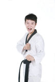Asian man playing  taekwondo Royalty Free Stock Image