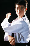 Asian man is playing with taekwondo Stock Image