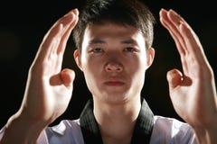 Asian man is playing with taekwondo Royalty Free Stock Photos