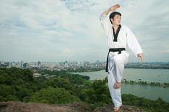 Asian man playing with taekwondo Stock Photography