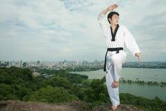 Asian man playing with taekwondo Stock Photography